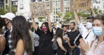 "Protester with a sign saying ""black lives matter""."