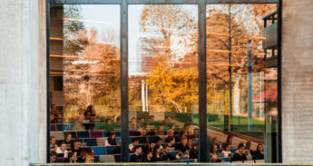Fall on campus, students in college
